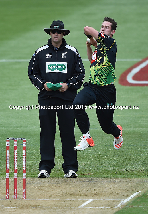 Adam Milne bowling as Umpire Chris Brown looks on during the Georgie Pie Super Smash Twenty20 Cricket match. Auckland Aces v Central Stags. Eden Park Outer Oval. Auckland, New Zealand. Sunday 15 November 2015. Copyright photo: Andrew  Cornaga / www.photosport.nz