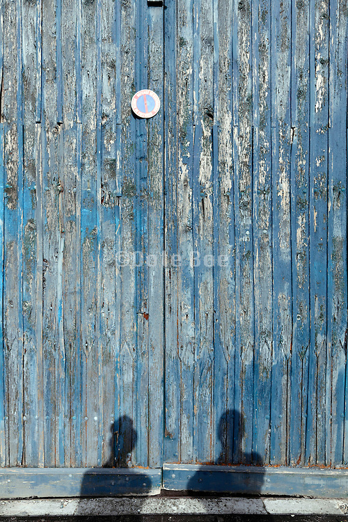 large old wooden door with shadow of two people