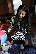 Kearny, New Jersey. November 19, 2013. Yadira Aleman looks over artwork her son Yolo made. Photo by Maya Rajamani/NYCity Photo Wire