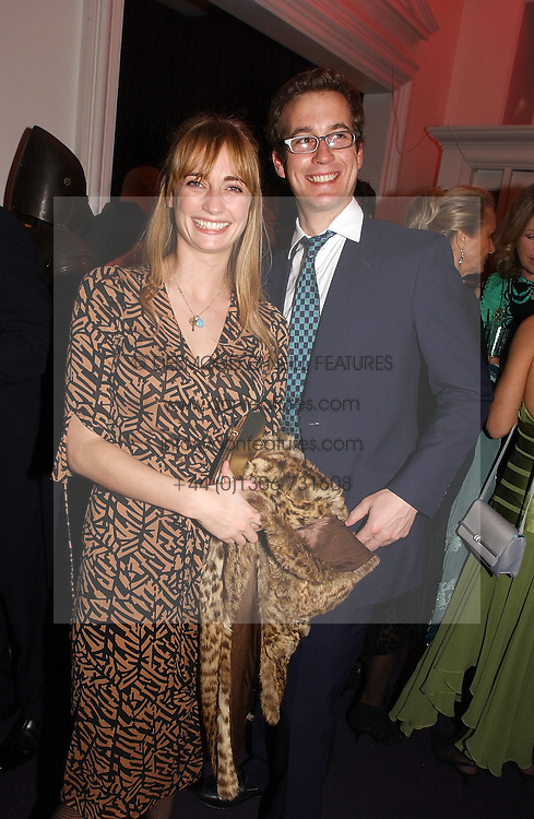 MISS CEMENTINE HAMBRO and MR ABE LYLE at a party hosted by jeweller Theo Fennell and Dominique Heriard Dubreuil of Remy Martin fine Champagne Cognac entitles 'Hot Ice' held at 35 Belgrave Square, London, W1 on 26th October 2004.<br /><br />NON EXCLUSIVE - WORLD RIGHTS