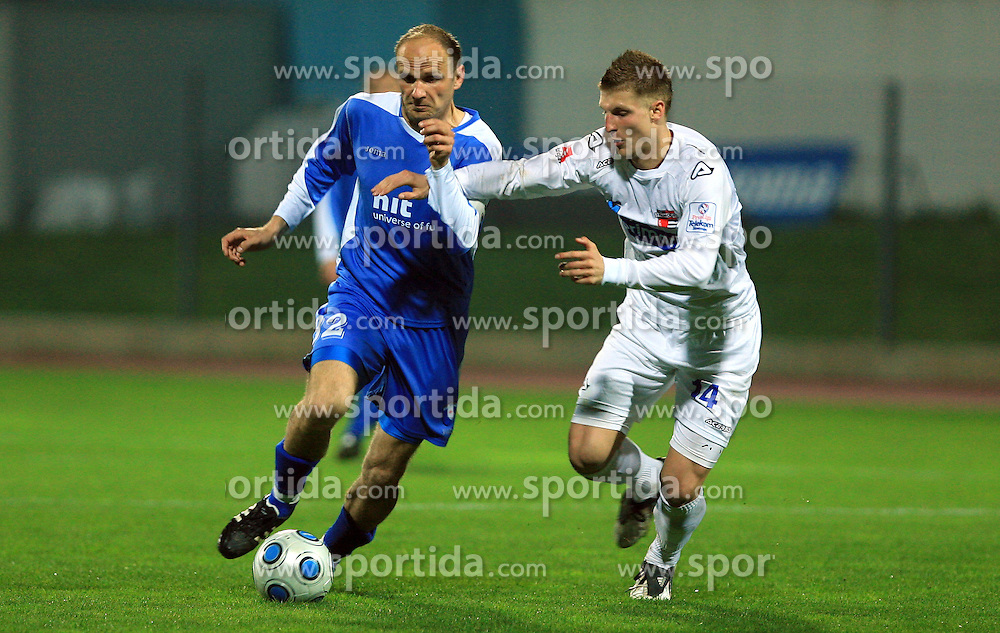 Milan Osterc of Hit Gorica and Saso Ogric of Primorje at 27th Round of Slovenian First League football match between ND Hit Gorica and NK Primorje Ajdovscina in Sports park Nova Gorica, on April 8, 2009, in Nova Gorica, Slovenia. (Photo by Vid Ponikvar / Sportida)