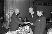 18/02/1963<br /> 02/18/1963<br /> 18 February 1963<br /> Irish Shell staff Social Club  long service award presentations at the Royal Hibernian Hotel, Dublin. Awards presented by Mr Young of Irish Shell, left.