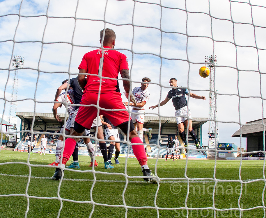 Ross County's Christopher Routis scoring their second goal. Dundee 1 v 2 Ross County, Scottish Premiership game played 5/8/2017 at Dundee's home ground Dens Park.