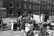 "15/06/1963.06/15/1963.15 June 1963.Dublin tenements evacuated at Fenian Street..The scene this morning at Fenian Street, Dublin as families living in century  old tenement houses evacuate their homes at No.9 and 10, and await the expected collapse of the buildings. ""The houses are only a few doors away from those which collapsed on Wednesday last, killing two schoolgirls. Most of the families spent the night on the roadside with their furniture..Dublin Tenements, collapsing in various parts of the city recently has caused a stste of emergency. Corporation officals are franticly trying to find alternative accomodation for hundreds of families occuping condemned or dangerous houses."""