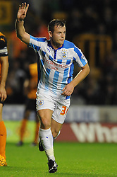 Huddersfield Town's Harry Bunn celebrates his goal. - Photo mandatory by-line: Dougie Allward/JMP - Mobile: 07966 386802 - 01/10/2014 - SPORT - Football - Wolverhampton - Molineux Stadium - Wolverhampton Wonderers v Huddersfield Town - Sky Bet Championship