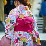 Rear view of a young Japanese woman wearing a kimono.