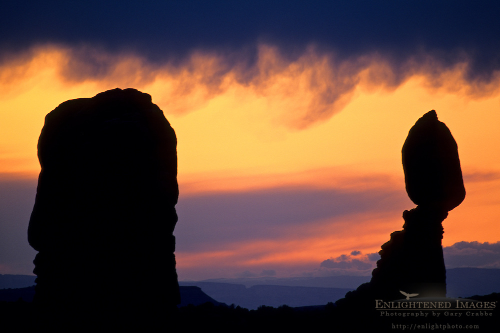 Stormy sunset light over Balanced Rock, Windows Section, Arches National Park, UTAH