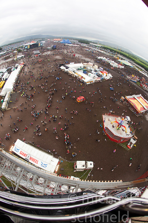 View from the ferris wheel, showing the mud filled main arena. Sunday at T in the Park 2012, held at Balado, in Fife, Scotland..