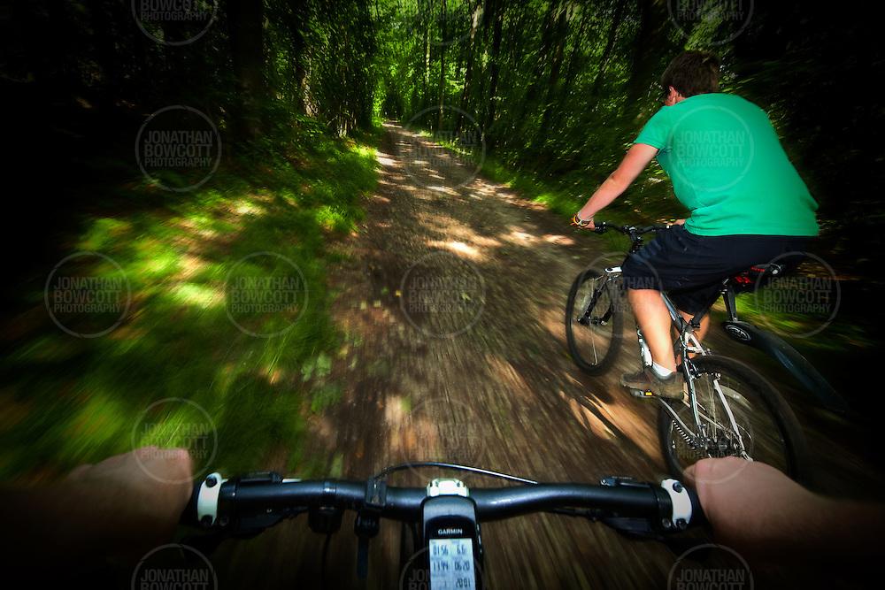 Action POV shot of Ben Nurser riding on one of the XC trails in Ashton Court near Bristol