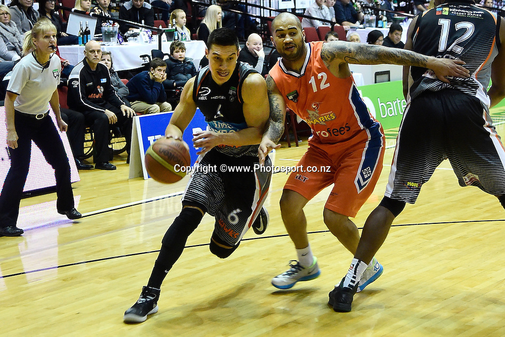 Jarrod Kenny (L) of the Hawks bursts past Kevin Braswell of the Sharks during a NBL - Hawks vs Sharks semi final four basketball match at the TSB Arena in Wellington on Friday the 4th of July 2014. Photo by Marty Melville/www.Photosport.co.nz