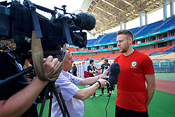 NANNING, CHINA - Tuesday, March 20, 2018: Wales' Chris Gunter speaks to BBC Radio Wales' Rob Phillips before a training session at the Guangxi Sports Centre ahead of the opening 2018 Gree China Cup International Football Championship match against China. (Pic by David Rawcliffe/Propaganda)