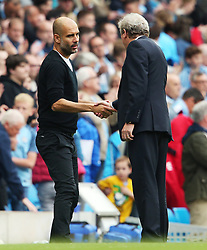 Manchester City manager Pep Guardiola shakes Crystal Palace manager Roy Hodgson's hand at full time - Mandatory by-line: Matt McNulty/JMP - 23/09/2017 - FOOTBALL - Etihad Stadium - Manchester, England - Manchester City v Crystal Palace - Premier League
