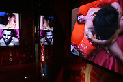 TV screens are showing people's faces at the time of their climax and during intercourse in the Orgasm Tunnel at Amora, the Academy of Sex and Relationships,on Tuesday, April 17, 2007, in London, UK. The world's first visitor attraction dedicated to love, sex and relationships opens its door officially tomorrow (18th of April 2007) in Piccadilly. The permanent interactive attraction, Amora, expects to draw over half a million, 18+ visitors in the first year and fuses entertainment, excitement and education in a unique powerful sensory experience. With seven zones covering every aspect of relationships from first filtrations and dating to fantasy and fetish. Visitors can explore the science of attraction - what they find attractive and why, learn how to enhance their skills and even create what their perfect partner might look like. Male and female models help demystify erogenous zones, G-spot and prostate, while insights and technique tips are offered on various topics. Sexual awareness and well-being are also covered thoroughly. ..