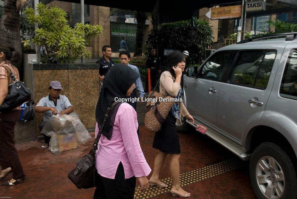 Scenes de rues dans le Triangle d'Or, Jakarta.  Street scenes in Jakarta Golden Triangle.