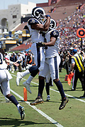 Los Angeles Rams wide receiver Pharoh Cooper (10) leaps and celebrates with a hip bump by Los Angeles Rams running back John Kelly (42) after Brown catches a 6 yard touchdown pass that ties the first quarter score at 7-7 during the 2018 NFL preseason week 3 football game against the Houston Texans on Saturday, Aug. 25, 2018 in Los Angeles. The Rams won the game 21-20. (©Paul Anthony Spinelli)