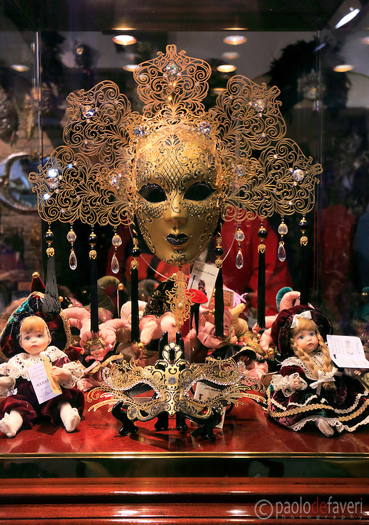 The window of a shop in Strada Nuova in Venice, Italy, selling carnival masks and other accessories.