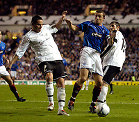 Photo: Jed Wee.<br /> Glasgow Rangers v Artmedia. UEFA Champions League.<br /> 19/10/2005.<br /> <br /> Rangers' Barry Ferguson (C) finds himself crowded out by the Artmedia defence and Ondrej Debnar.