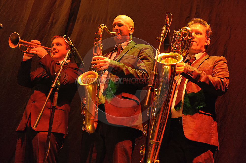 GLASGOW, SCOTLAND, JULY 20, 2008: Mark Ronson's horn section plays on stage as part of the opening act for Jay-Z inside the SECC Arena in Glasgow, Scotland (Martin McNeil)