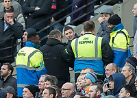 Football - 2016 / 2017 Premier League - West Ham United vs. Stoke City<br /> <br /> Stewards deal with trouble amongst the home supporters at The London Stadium.<br /> <br /> COLORSPORT/DANIEL BEARHAM
