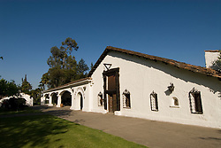 Chile Wine Country: Undurraga Winery, Vina Undurraga, near Santiago.  White winery building, horizontal, historical..Photo #: ch410-33882.Photo copyright Lee Foster, 510-549-2202, www.fostertravel.com, lee@fostertravel.com.
