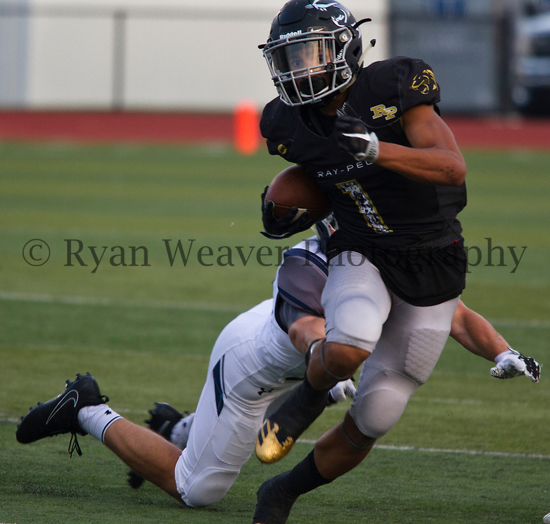 Chris McKinzy, Jr., of Ray-Pec makes a Lee's Summit West defender miss Friday night at Panther Stadium. McKinzy tallied 74 yards on 21 carries.