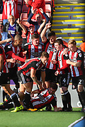 Sheffield United celebrate goal scored by Sheffield United midfielder Chris Basham (6) to go 1-0 during the EFL Sky Bet Championship match between Sheffield Utd and Ipswich Town at Bramall Lane, Sheffield, England on 14 October 2017. Photo by Ian Lyall.