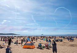 "© Licensed to London News Pictures.  24/06/2018; Weston-super-Mare, North Somerset, UK. The RED ARROWS at Weston Air Festival. The Red Arrows draw the number ""100"" with smoke in the sky to celebrate the Centenary of the RAF. Air displays take place over the Seafront and Beach Lawns at Weston-super-Mare, including the Battle of Britain Memorial Flight and the Red Arrows display team. Photo credit: Simon Chapman/LNP"