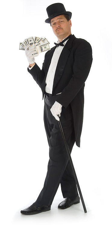 Man in tuxedo, top hat and cane fanning himself with stacks of money