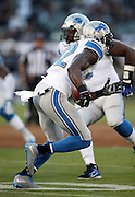 Detroit Lions strong safety James Ihedigbo (32) runs with the ball after intercepting a first quarter pass during the 2014 NFL preseason football game against the Oakland Raiders on Friday, Aug. 15, 2014 in Oakland, Calif. The Raiders won the game 27-26. ©Paul Anthony Spinelli