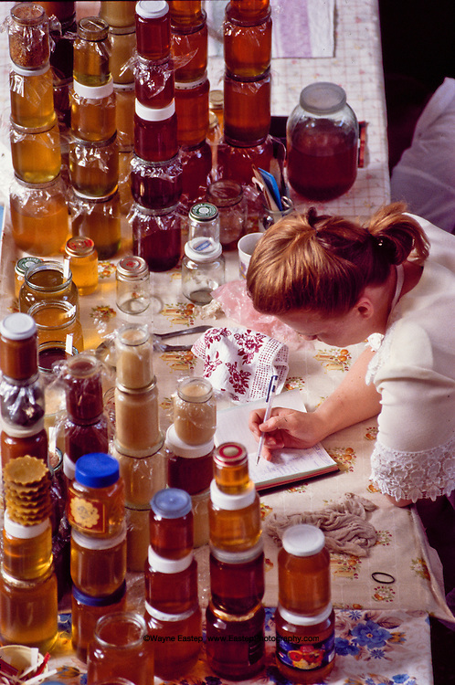 A honey vendor at the Zelyony bazaar (the green market) in Almaty does her bookkeeping.  Kazakhstan has an astonunding variety of honey.  A profusion of wildflowers and blossoms produces some of the most flavorful honey in Central Asia and Russia.