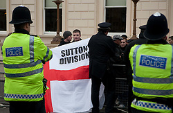 ©London News Picures. Member of EDL ( English Defence League) and English Nationalist Alliance protest against Sharia Law outside Downing Street in London December 11, 2010. Photo credit should read Fuat Akyuz/London News Pictures.