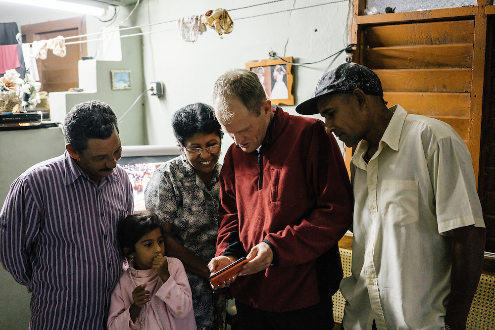 Ornithologist Martjan Lammertink, center, catches up with Jabao, right, and his family in Fallarones in Eastern Cuba on Jan 24, 2016.