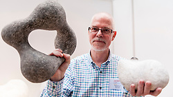 © Licensed to London News Pictures. 08/04/2016. London, UK. The ceramicist Martin Pearce poses with his works.  The leading international fair for contemporary ceramics, Ceramic Art London 2016, opens at its new venue of Central Saint Martins, King's Cross.  88 emerging and established ceramicists from around the world are presenting and their latest works for sale to the public with prices ranging from £30 to £10,000. Photo credit : Stephen Chung/LNP