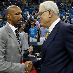 April 28, 2011; New Orleans, LA, USA; New Orleans Hornets head coach Monty Williams and Los Angeles Lakers head coach Phil Jackson talk following game six of the first round of the 2011 NBA playoffs at the New Orleans Arena. The Lakers defeated the Hornets 98-80 to advance to the second round of the playoffs.   Mandatory Credit: Derick E. Hingle