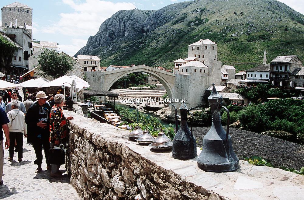 Stari Most, Old Bridge, following reconstruction, tourists and Neretva River, Mostar, Bosnia Herzegovina, Former Yugoslavia