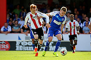 Brentford midfielder Ryan Woods (15)  battles for ball with Ipswich striker Freddie Sears (20) during the EFL Sky Bet Championship match between Brentford and Ipswich Town at Griffin Park, London, England on 13 August 2016. Photo by Matthew Redman.