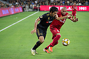 LAFC forward Carlos Vela (10) dribbles the ball while being defended by Toronto FC defender Auro (96) during a MLS soccer game between the LAFC and the Toronto FC. LAFC and Toronto FC tied 1-1 on Saturday, Sept 21, 2019, in Los Angeles. (Ed Ruvalcaba/Image of Sport)
