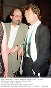 Mick Jagger and Salman Rushdie. Royal Court Theatre 40th Anniversary Gala. Porchester Hall. 31/10/96. Film 96709f37<br />