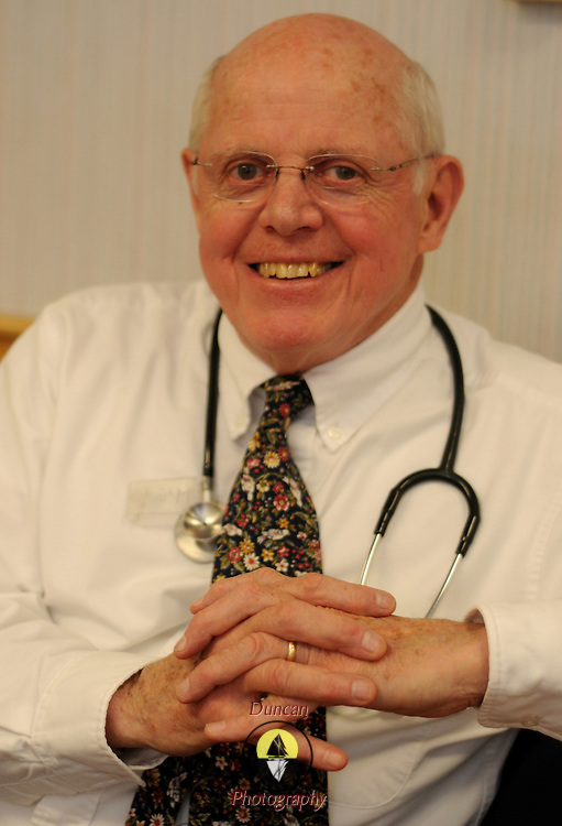 "Dr. Peter McGuire, founder of Oasis Health Network, a free health care network in Brunswick says, ""It's not that we are trying to do a better job than other practitioners, it's that we can -- because we don't have the overhead."" Using lent space, volunteer staff and donated medications, Oasis doctors and staff see about 800 different people each year - in 2,800 visits. The organization, founded, by McGuire in 1995, is supported by many other local organizations and provides a broad spectrum of healthcare services, all donated.   Photo by Roger S. Duncan."