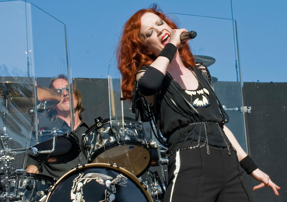 Garbage drummer Butch Vig and lead singer Shirley Manson performs during the band's set on the main stage at the 2012 KROQ Weenie Roast y Fiesta at Verizon Wireless Amphitheater.