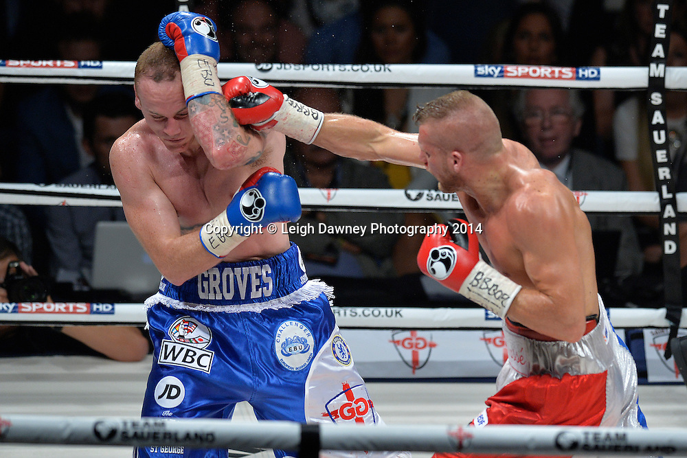 Christopher Rebrasse throws a right hand on George Groves during the EBU (European) Super Middleweight Title & Vacant WBC Super Middleweight Title fight at the SSE Wembley Arena, London on the 20th September 2014. Sauerland Promotions. Credit: Leigh Dawney Photography.