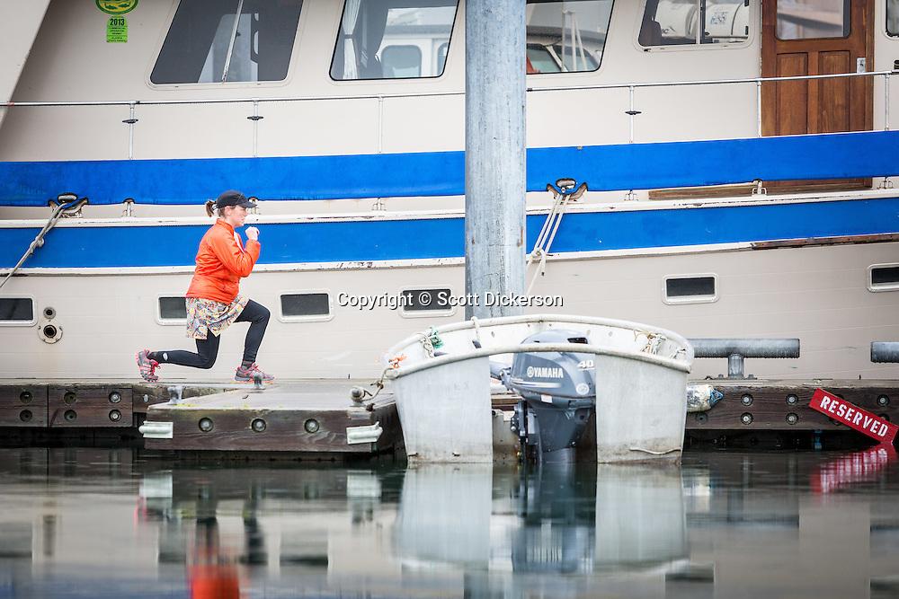 Homer Women's Nordic doing dryland training for cross country skiing in the Homer harbor, Homer, Alaska.
