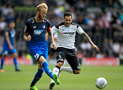 Derby County's Bradley Johnson (Right) and TSG 1899 Hoffenheim's Kevin Vogt battle for the ball.