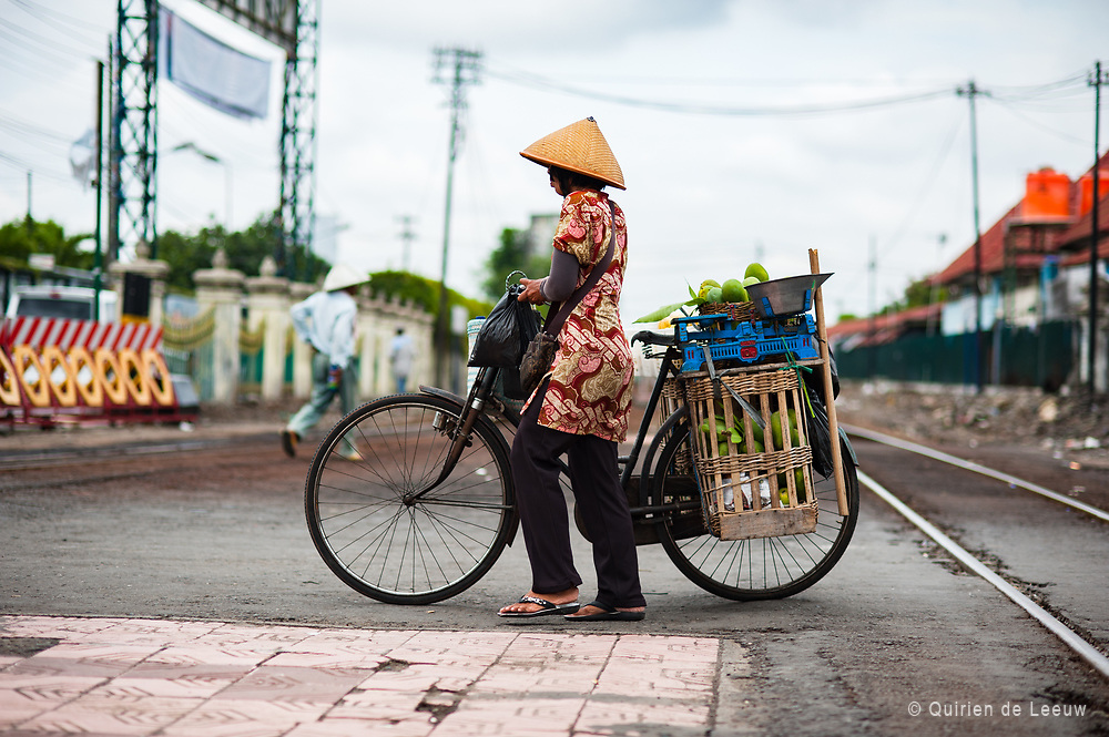 Woman with bike in Yogjakarta, Java Indonesia.