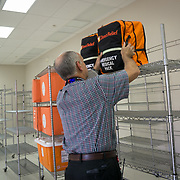 OCTOBER 6, 2017--PONCE, PUERTO RICO ---<br /> Allan Cintron Salichs, left, Executive Director of Med Centro in Ponce,stores one of the Emergency Relief Backpacks given to Med Centro by Direct Relief.<br /> (Photo by Angel Valentin/Freelance)