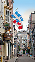 In the old town of Quebec City the provincial flag of Quebec flys alongside the Canadian flag. The narrow street, Rue Garneau, ends at the Seminaire de Quebec.