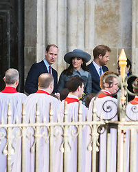 Westminster Abbey, London, March 14th 2016.  Her Majesty The Queen, Head of the Commonwealth, accompanied by The Duke of Edinburgh, The Duke and Duchess of Cambridge and Prince Harry attend the Commonwealth Service at Westminster Abbey on Commonwealth Day. PICTURED: The Duke and Duchess of Cambridge emerge from the Abbey with Prince Harry at the end of the service.