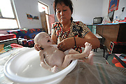 CHANGZHI, CHINA - JULY 27: (CHINA OUT)<br /> <br /> 80-day-old Baby With No Anus, little baby Guo Enze is seen having a bath, Guo who has no anus at Chuandi Village in Huguan Town, Changzhi City, Shanxi Province of China. <br /> 80-day-old Guo Enze born without anus ate a little milk everyday and defecated toughly from penis. A charity project found Guo and donated milk powder to him. <br /> ©Exclusivepix Media