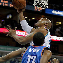 Oct 10, 2009; New Orleans, LA, USA; New Orleans Hornets forward David West (30) shoots over Oklahoma City Thunder guard James Harden (13) during the first quarter at the New Orleans Arena. Mandatory Credit: Derick E. Hingle-US PRESSWIRE