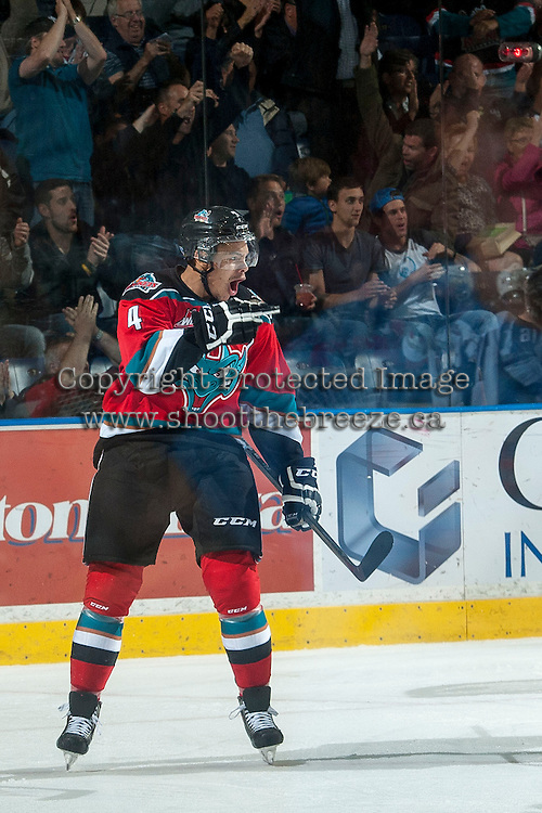 KELOWNA, CANADA - OCTOBER 1: Captain Madison Bowey #4 of Kelowna Rockets celebrates the tying goal against the Vancouver Giants during the second period on October 1, 2014 at Prospera Place in Kelowna, British Columbia, Canada.   (Photo by Marissa Baecker/Shoot the Breeze)  *** Local Caption *** Madison Bowey;